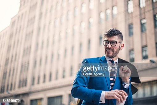 Modern man holding coffee cup