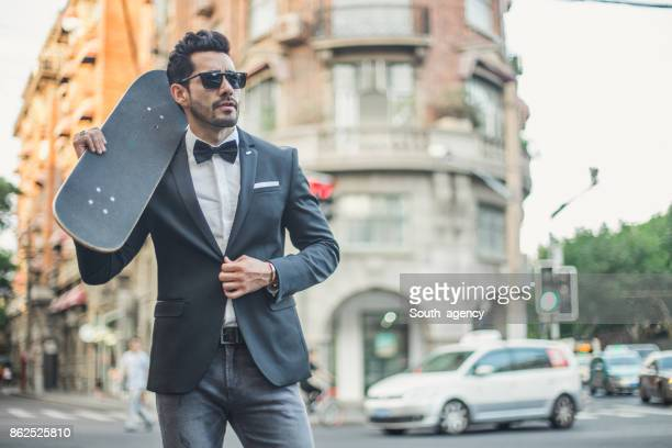 Modern man with skateboard