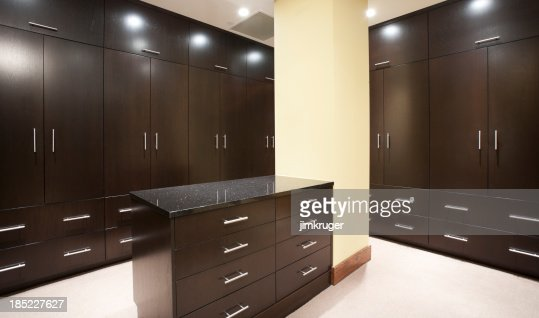 Modern Master Closets modern master bedroom closet with dark stain stock photo | getty