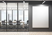 Modern meeting room corridor with blank banner on concrete wall, city view and daylight. Mock up, 3D Rendering