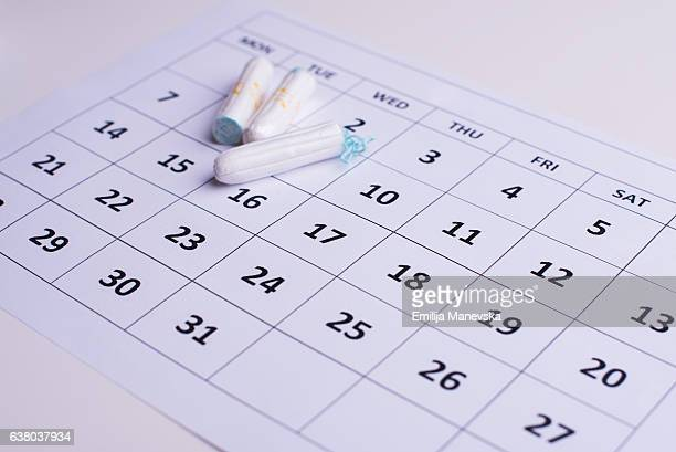 Modern Menstruation. Clean white tampons and Calendar