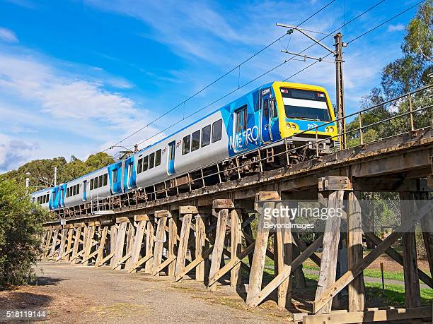 Modern Metro train on old wooden Eltham viaduct
