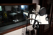 Modern microphone in recording studio, selective focus