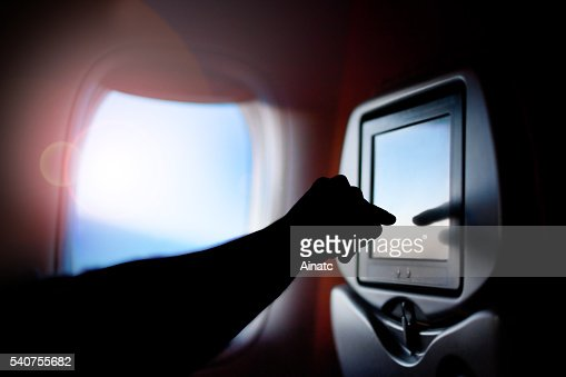 Modern monitor passenger seat on the plane. Airplane window. : Stock-Foto
