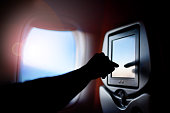 Seat passenger on the plane screen monitor. Window air travel.