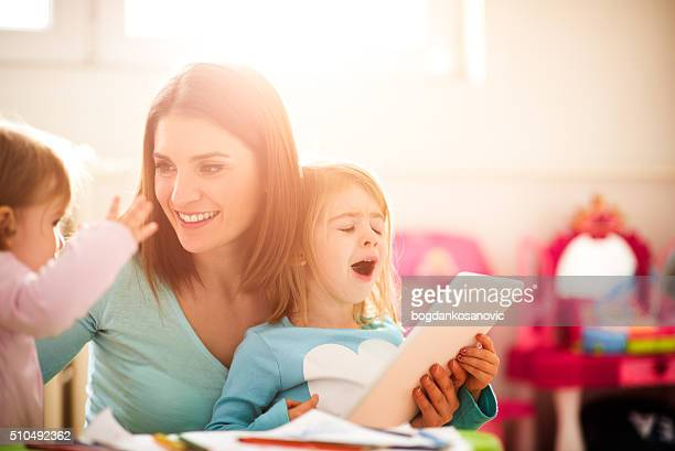 Modern mother with daughters