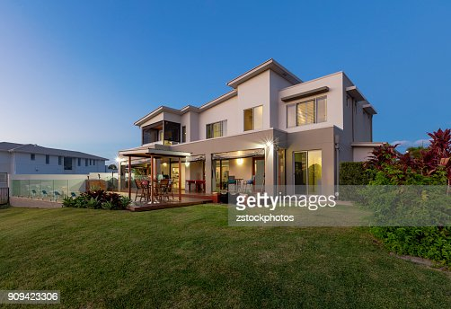 Modern multilevel house exterior with pool : Stock Photo