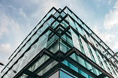 A modern office building facade made of glass