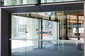 Modern office building glass door with reflection, background with copy space, full frame horizontal composition