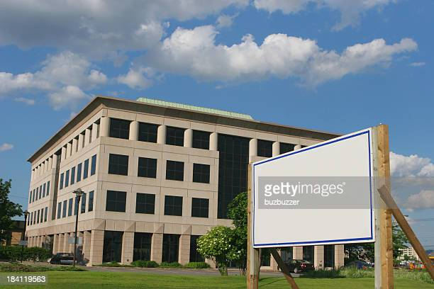 Modern Office Building with a blank real estate sign