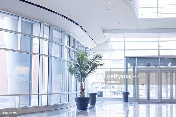 Modern office lobby with glass wall