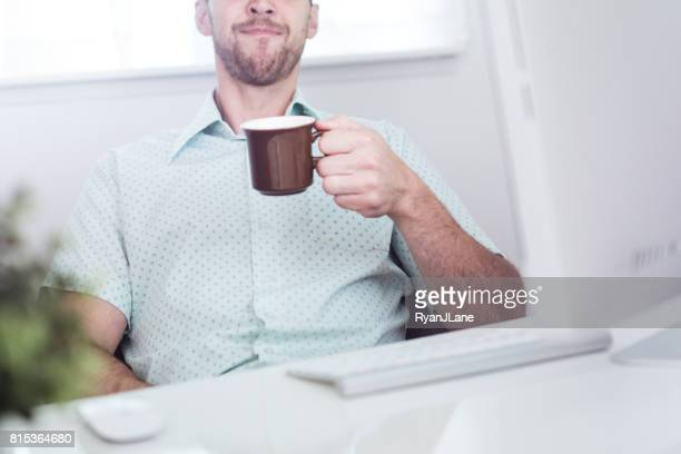 Modern Office Worker with Coffee