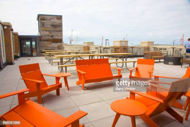 Modern orange seats on Cleveland lounge roof