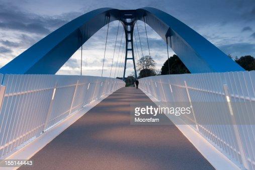 Modern pedestrian bridge over the M5 motorway