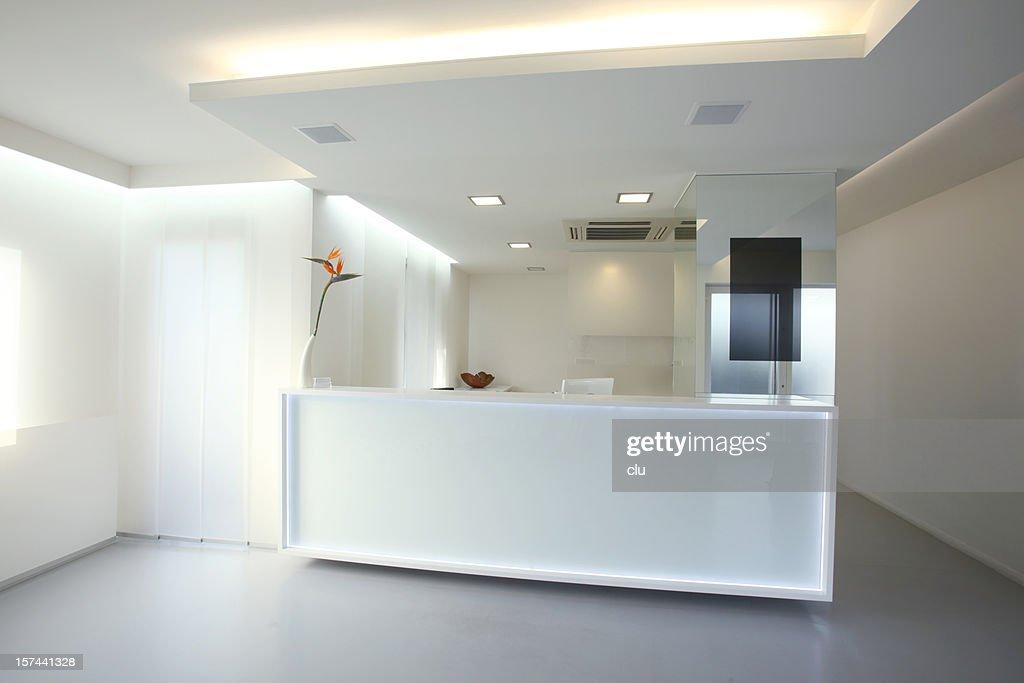 modern reception desk in grey white color xxxl stock photo