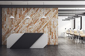 Modern office interior with reception desk and clean wooden wall. 3D Rendering