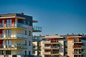 Modern residental buildings of brick and glass on urban street.