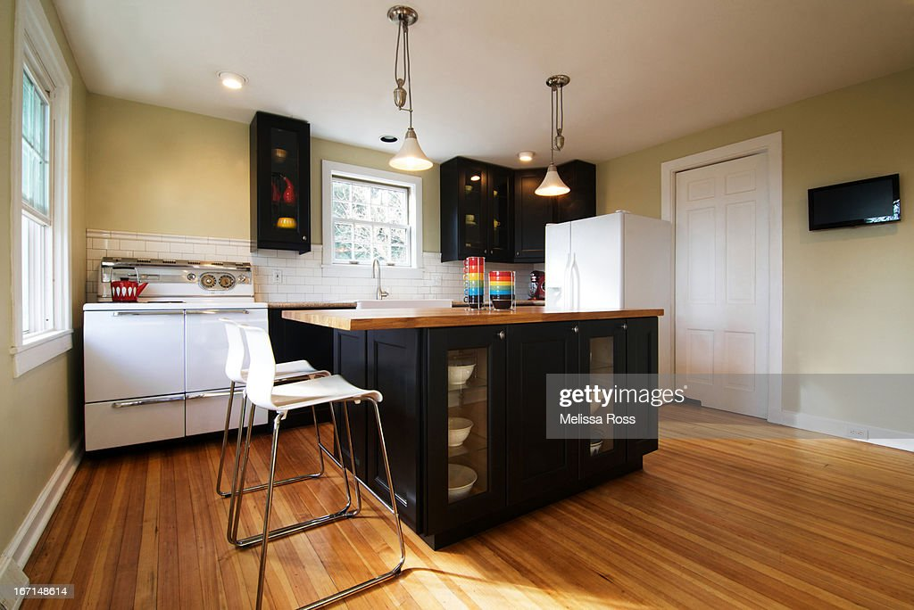 Modern residential kitchen with dark cabinets : Stock Photo