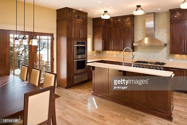 Modern residential kitchen with maple and stainless.