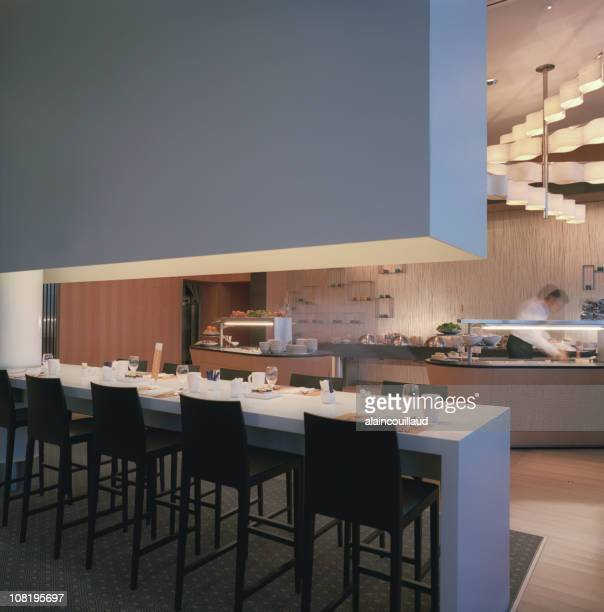 Modern Restaurant Interior with Bar Facing Kitchen