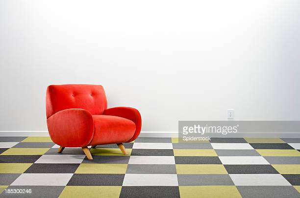 Modern Room With Checkered Carpeting & Armchair