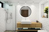 Modern Scandinavian style bathroom. White brick tiles, circle mirror, wood. lots of decorative light