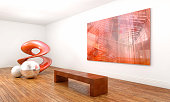 Modern art sculpture and abstract painting, with a contemporary conceptual style, inside an art gallery with white walls and brown wooden floor. The sculpture - which is made of three geometric elemen