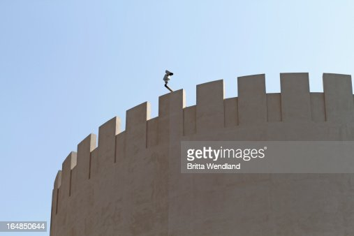 Modern security camera placed on old arabesque fort