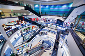 Modern shopping mall interior. Busy sale time