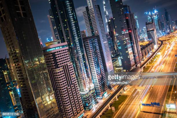 Modern Skyscrapers and Busy Traffic in Dubai at Night