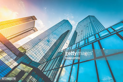 Modern skyscrapers in business district at sunset with lens flare effect : Stock Photo