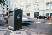 A modern clever trash can on the street in Prague in the Czech Republic. Collection of waste in Europe for subsequent disposal. Eco-friendly waste collection