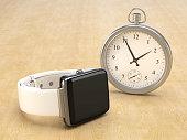 A modern smartwatch against a vintage watch