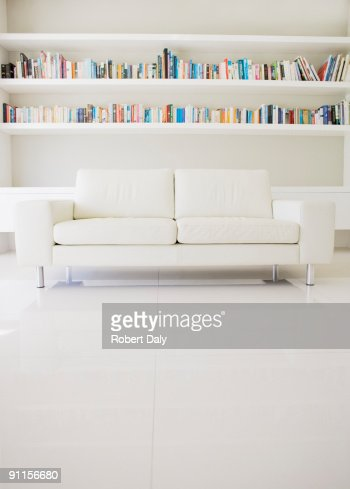 Modern sofa and shelves in living room stock photo getty Modern shelves for living room