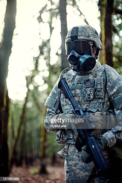 Modern Soldier in Dark Woods with Gun