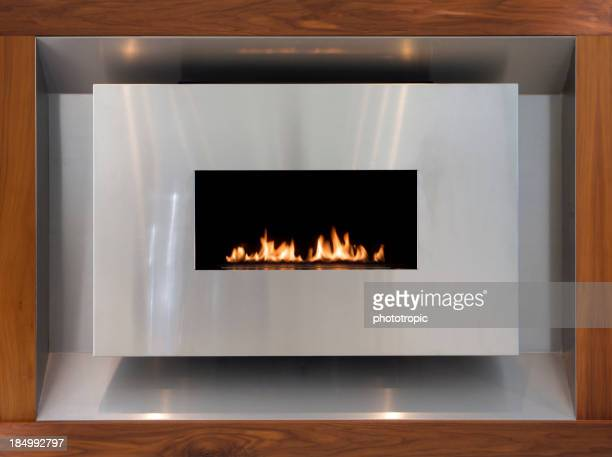 modern stainless steel and walnut gas fire