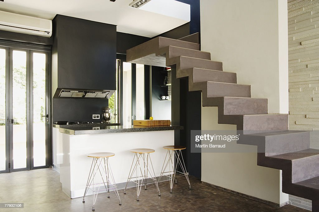 Modern stairs over kitchen : Stock Photo