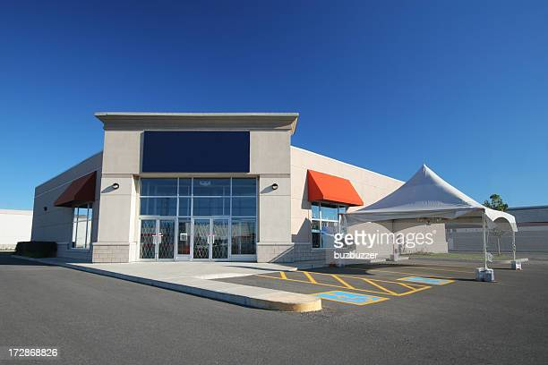 Modern Store Building with a white marquee promotion Tent