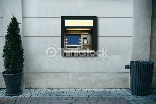 Modern street ATM machine for withdrawal of money and other financial transactions : Stock Photo