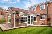 Modern Sunroom or conservatory extending into the garden, surrounded by a block paved patio