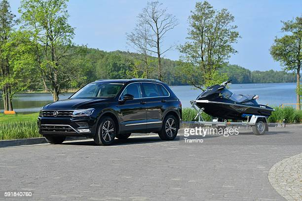 Modern SUV with trailer and jet ski