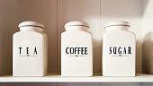 Modern tea coffee and sugar bowl in pantry shelf