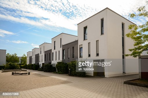 Modern townhouses in a residential area, new apartment buildings with green outdoor facilities in the city : Stock Photo