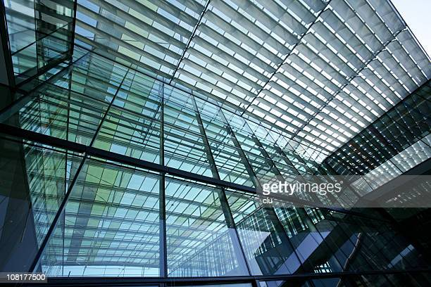 Modern transparent glass building front and roof view