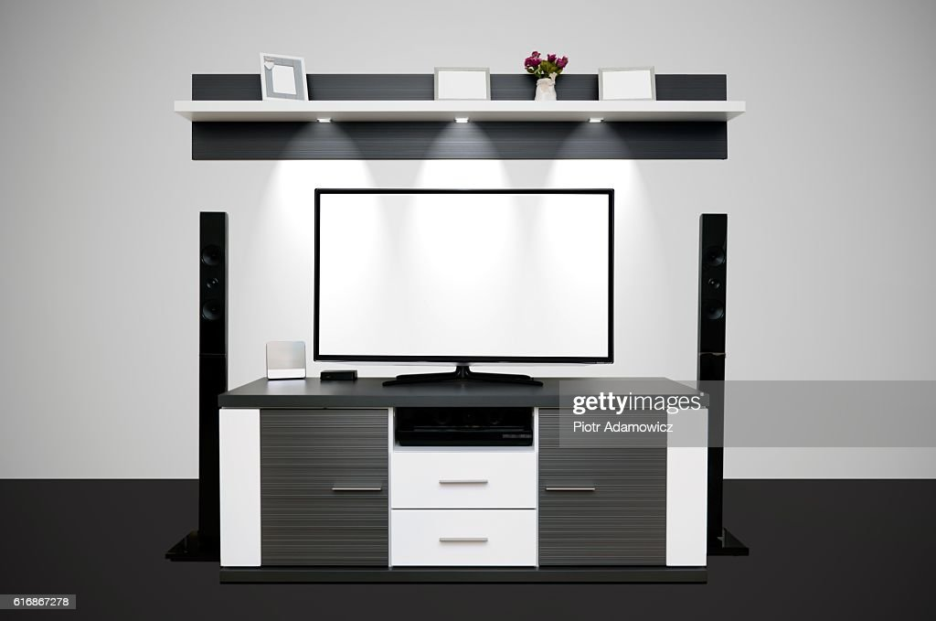 Modern TV room with illuminated LED lamps : Stock Photo