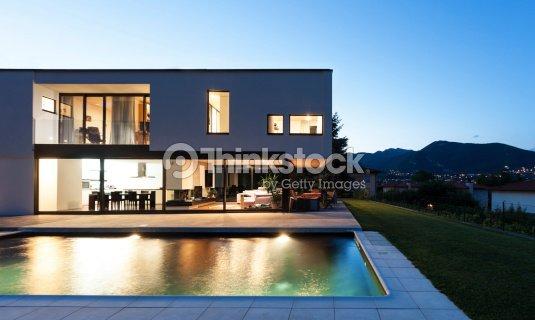 modern villa night scene stock photo thinkstock. Black Bedroom Furniture Sets. Home Design Ideas