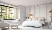 Modern vintage bedroom with black and white 3d rendering image. There is a  white wood floor,white brick wall and finished with white furniture.There are large window overlooking the nature