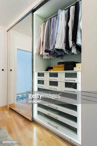 Modern wardrobe interior : Stock Photo