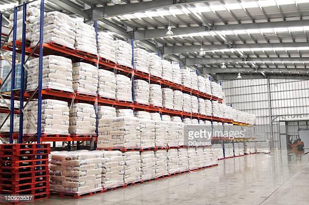 Modern warehouse with shelves full of stacked goods.