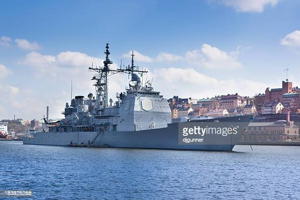 Modern warship in harbour